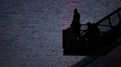 Couple People Enjoying River Flow Sunset Dusk Silhouettes Stock Footage