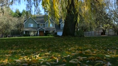 Family home exterior in fall - stock footage