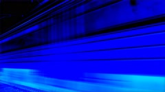 Train moves to the right along the rails. Blue. - stock footage