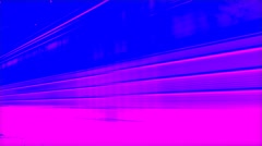 Train moves to the right along the rails. Pink and blue. - stock footage