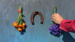 hanging  old horseshoe and medical herbs flowers on old blue  wall - stock footage