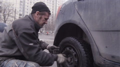 Stock Video Footage of Replacement of the wheels on the vehicle.