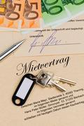 home keys and rental agreement - stock photo