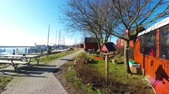 Going for a walk in a small cosy harbor Stock Footage