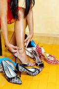 woman with many shoes to choose from - stock photo