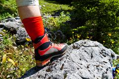 Hiking boots for hiking in the mountains Stock Photos