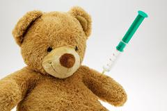 teddy bear with injection - stock photo