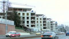 City - road with cars - construction of new building (block of flats) Stock Footage