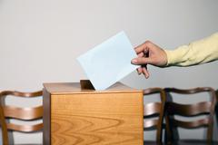 Women in election with ballots and ballot box Stock Photos