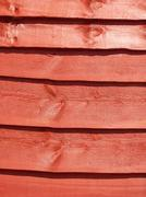 Close-up photo of a stained fence panel - stock photo