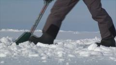 Man prepare base for ice fishing tent 3 Stock Footage