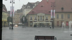 Heavy rain in central square of European medieval town Stock Footage