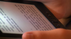 Reading an eBook, tablet, modern technology, holding a device, close up Stock Footage