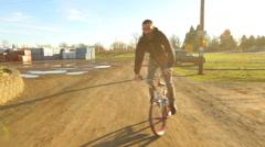 BMX rider going up street. Stock Footage