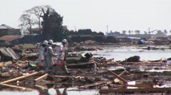 Japanese police search for tsunami survivors Stock Footage