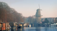 Windmill Overlooking Pretty Canal Area Stock Footage