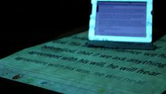ipad on desk with projected Bible passage 3 - stock footage