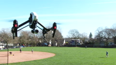 Drone Quad Helicopter Flying in City Park Stock Footage