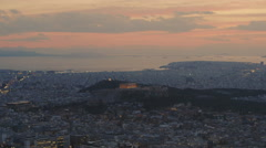 Acropolis lights up at sunset/dusk skyline overview real time wide view Stock Footage
