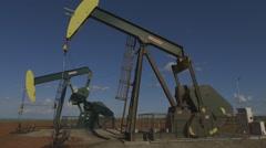 Oil Pumpjacks operating Stock Footage