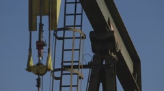 Detail shot of oil pumpjack in operation Stock Footage