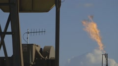 Detail shot of oil pumpjack and natural gas flare Stock Footage