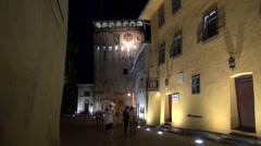 Sighisoara,Transylvania,birthplace of Dracula,old yellow house,night,tourists - stock footage