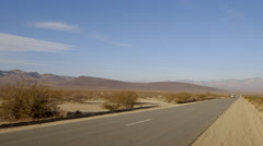 California desert truck drives down long road Stock Footage