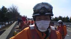 Japanese Firebrigade rescue tsunami survivors Stock Footage