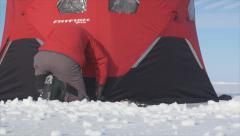 Securing ice fishing tent 2 Stock Footage