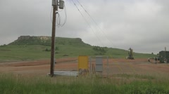 Machinery and trucks pumping fracking fluid in Bakken Stock Footage