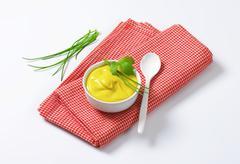 Bowl of smooth Dijon mustard - stock photo