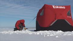 Securing ice fishing tent 3 Stock Footage
