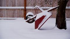 Wheelbarrow in snow storm Stock Footage