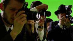 Stock Video Footage of Group of paparazzi. Photo shoot on green screen. Slow motion.