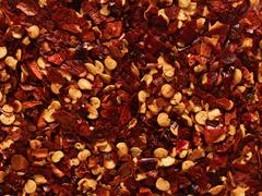 dried red chili flake food background - stock photo