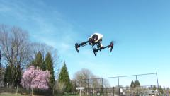 Quadcopter Drone Landing Stock Footage