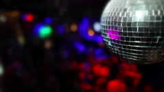 Nightclub dancing and flashing lights. Focus on  foreground disco ball. Concept Stock Footage