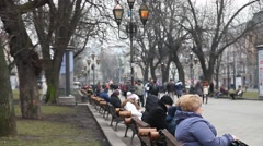 People resting on Lviv center alley benches Stock Footage