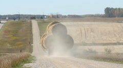 Rear view of truck loaded with hay bales. Manitoba, Canada. Stock Footage