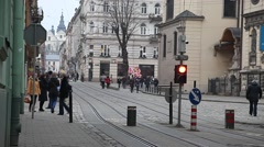Busy street in center Lviv with tram riding Stock Footage