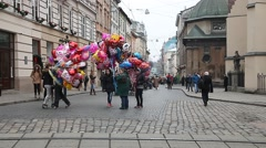 Busy street in center Lviv with sellers of baloons Stock Footage
