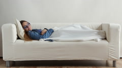 Girl lying on couch relaxed or taking power nap after lunch Stock Footage