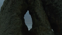 View of Ruby beach through rock formation Stock Footage