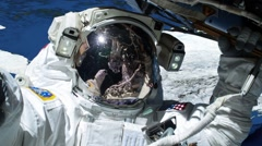 Close up of astronaut outside spacecraft and world moving behind him Stock Footage
