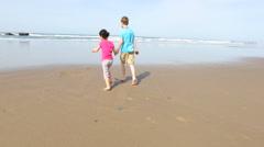 Kids running at beach - stock footage