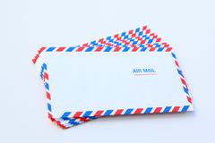Air mail correspondence letter over white Stock Photos