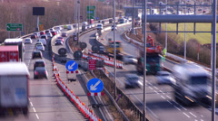 Time lapse of traffic flowing through road works on the A14 dual carriageway Stock Footage