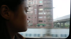 Close Up Of A Asian Woman's Face On A Train, thinking At The View-Dan Stock Footage