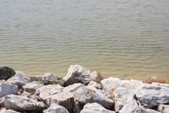 stones at riverbank - stock photo